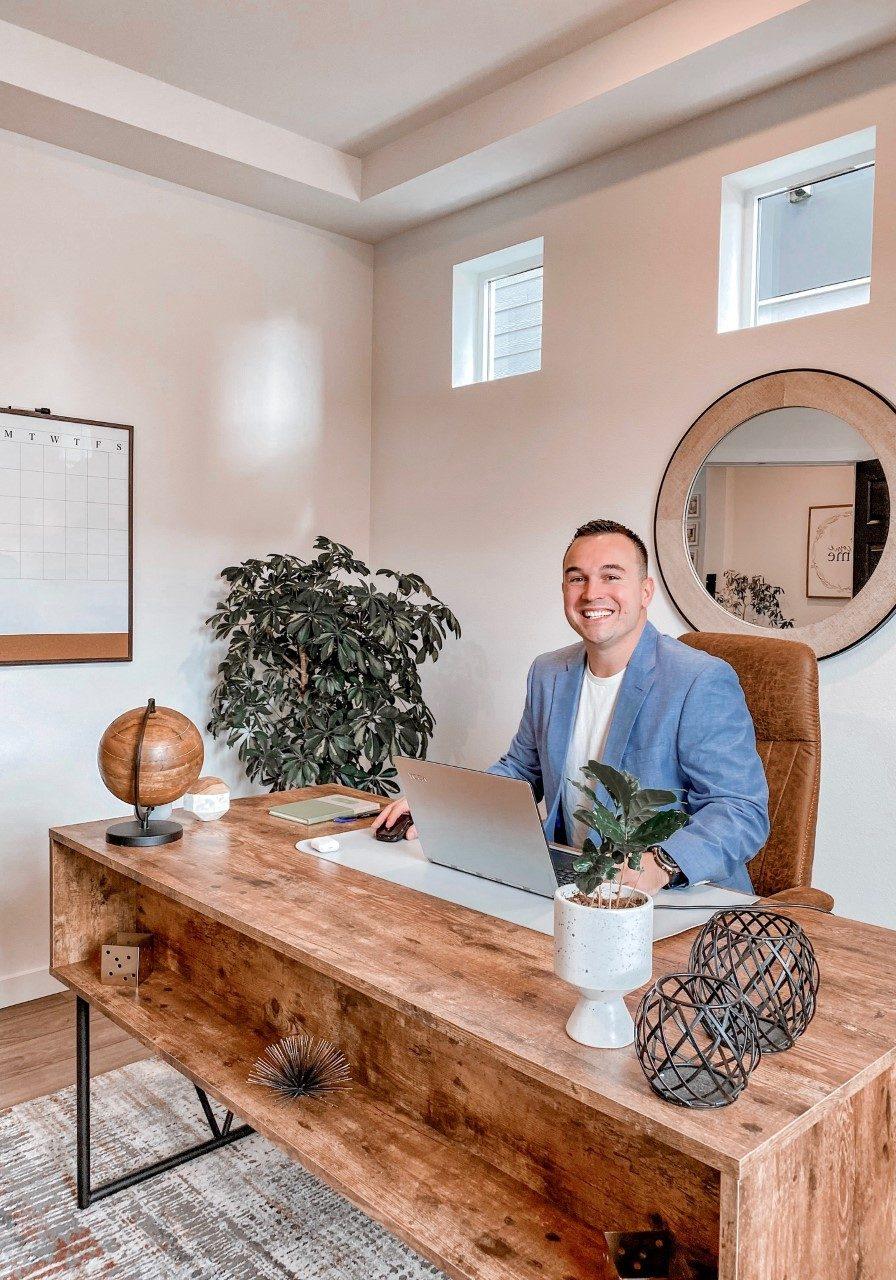 Tyler Freed Realtor at Modern Wood Desk